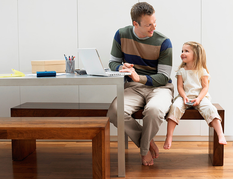 Father and daughter at work together. Mindful parenting.