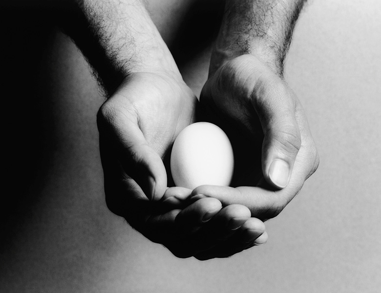 A picture of a man holding an egg represents the idea of taking responsibility for one's own emotions.