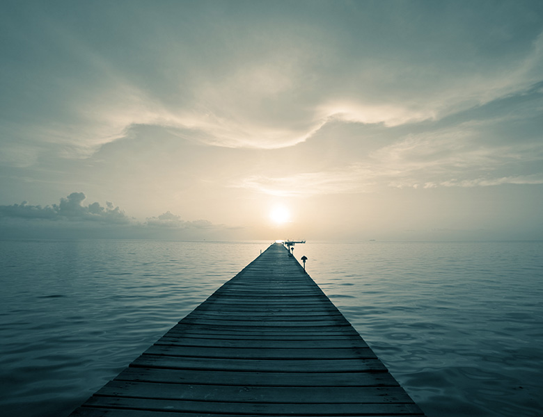 A long dock symbolizing the courage of taking a chance.